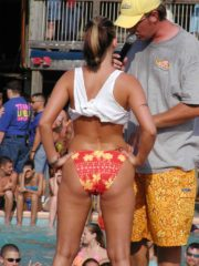 A Wet T-Shirt Contest at the Club La Vela. Nipples Show Through as these Girls Show Their Tits on Public Stage. See Cute Asses in Thongs and Boobs
