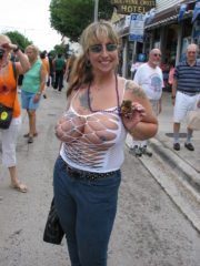 Girls Flashing Tits and Ass at Fantasy Fest, Both Naked and in Body Paint. Showing their boobs and butts for the crowd for beads.