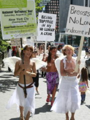 Girls showing their boobs at the annual Go Topless day in New York City. Women with Painted Tits and Painted Bodies.
