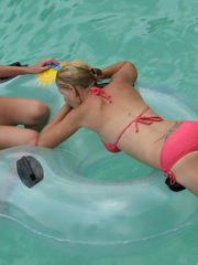 Sexy Girl at Water Park in Bikini and Thong. Showing off Tight Ass and bare Tits going down a Water Slide or Lazy River..