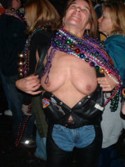 Sexy, Hot Women Flash Their Boobs for Beads at Mardi Gras in New Orleans.  Watch Girls Flashing Their Tits and Ass for you and the Camera.