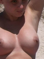 Naked Girls showing Tits, Ass and Pussy at the Nudist Beach